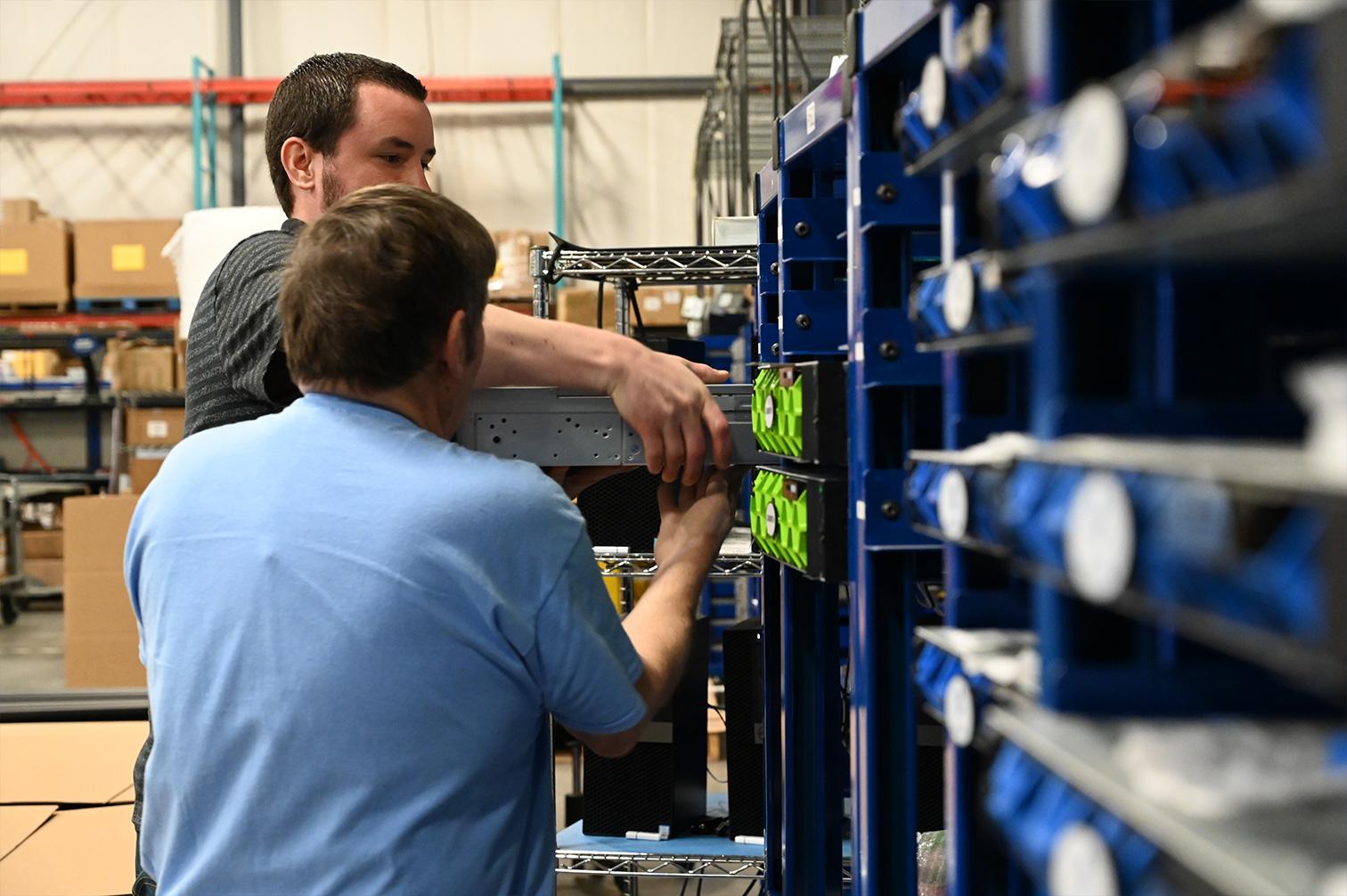 WCA team members installing a server rack