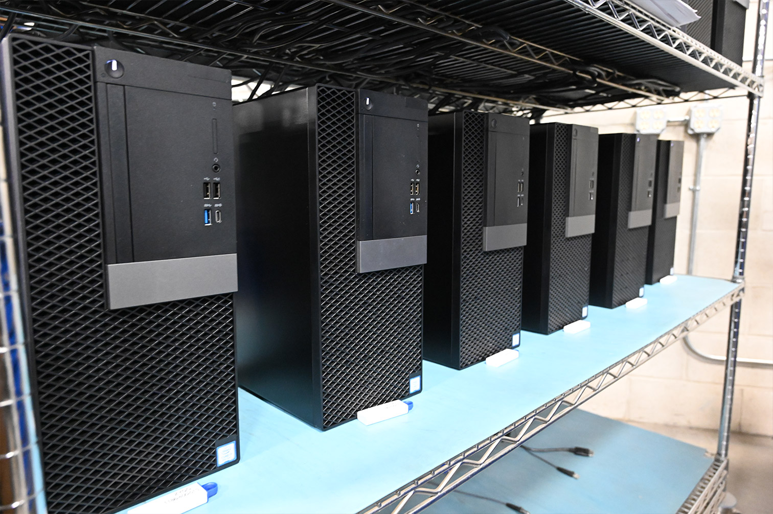 Computer towers on a shelf in WCA warehouse