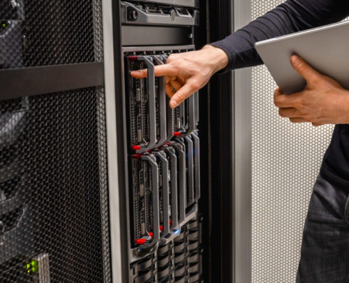 A technical worker checking a computer server
