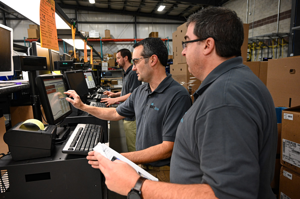 wca oem team members testing a computer system