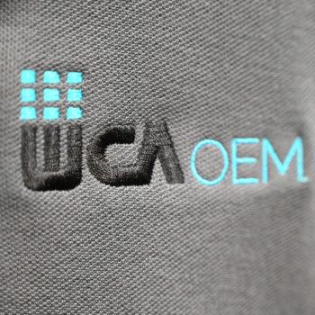 WCA OEM logo stitched on gray company polo